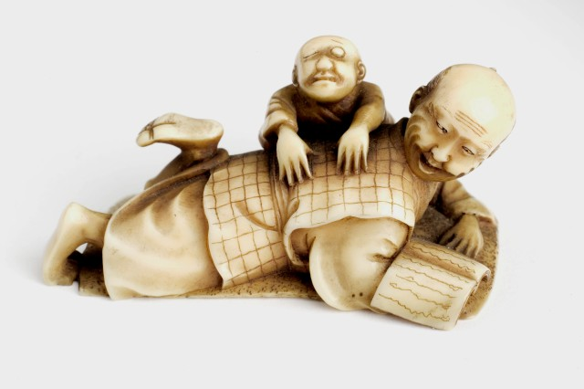 L0058581 Ivory figure of man massaging the back of another man. Japan
