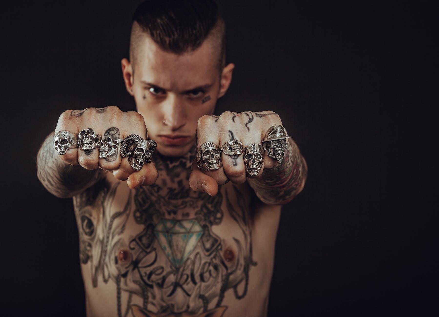 man wearing silver skull ring