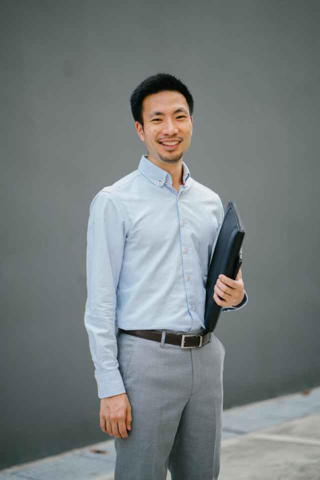 man holding black laptop bag