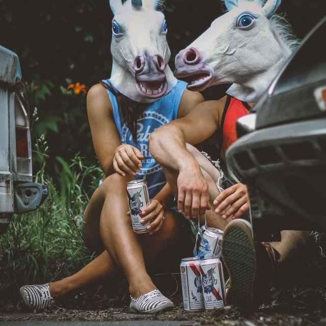 couple wearing horse mask